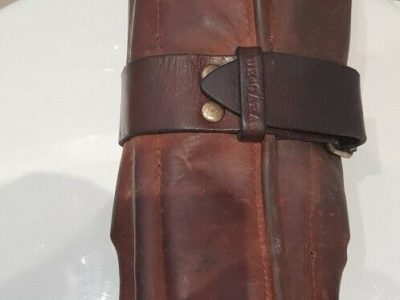 LOST brown leather tool roll containing tools, fastens with single large buckle
