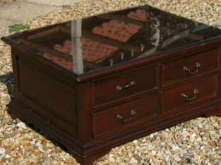 mahogany coloured 8 drawer coffee table glass topped