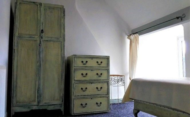 Trio of matching painted antique furniture