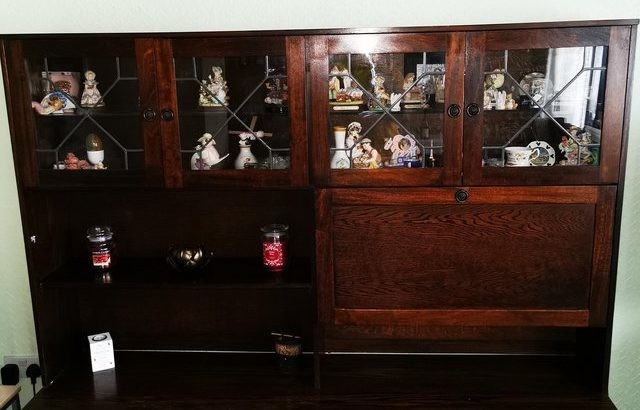 Wooden display cabinet with glass doors