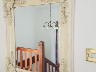 Ornate cream mirror