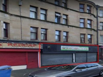 Large shop to let on main busy road (rent reduced for quick let)